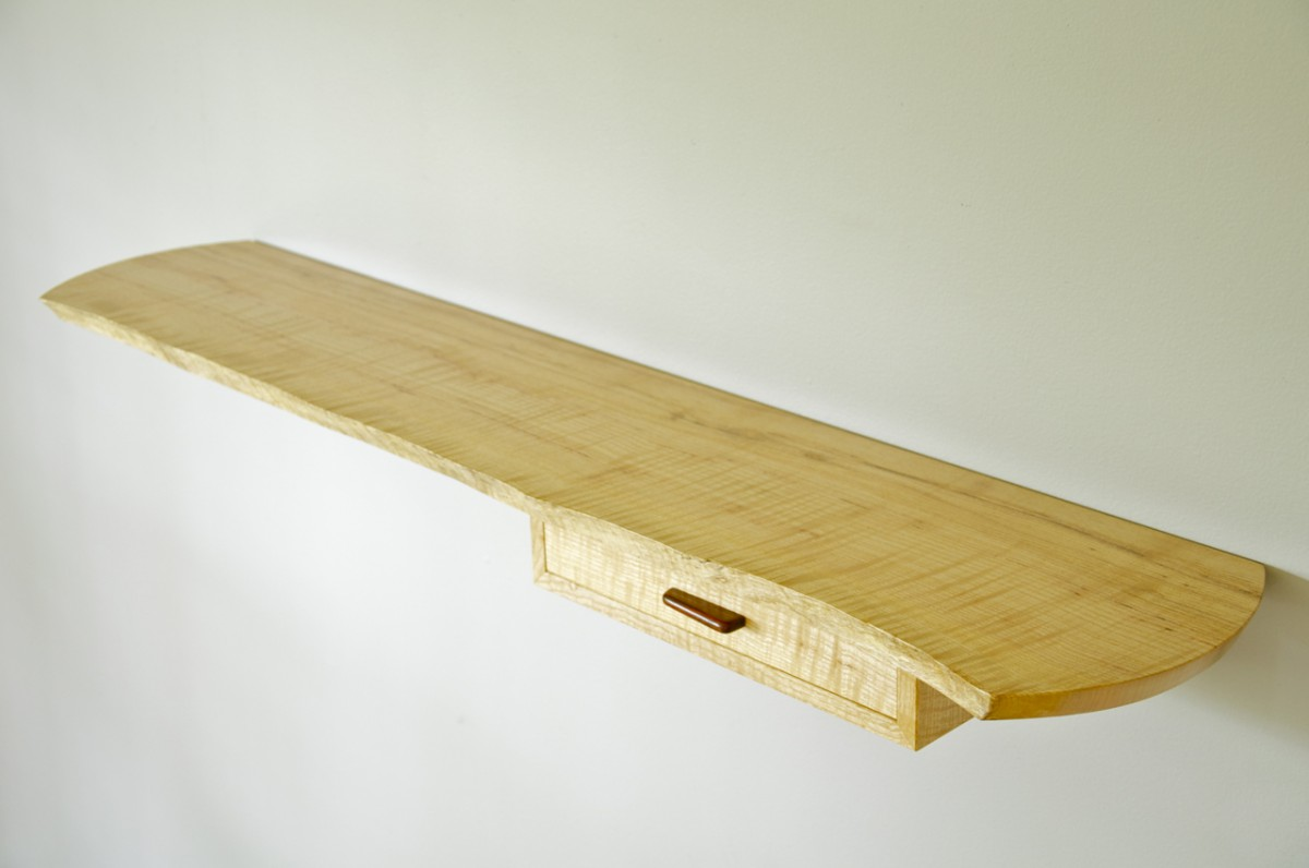 Floating, live edge wall shelf from above